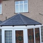 Conservatory roof in fibreglass slate tile panels