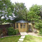 Grp slate tile roof on summerhouse / chalet